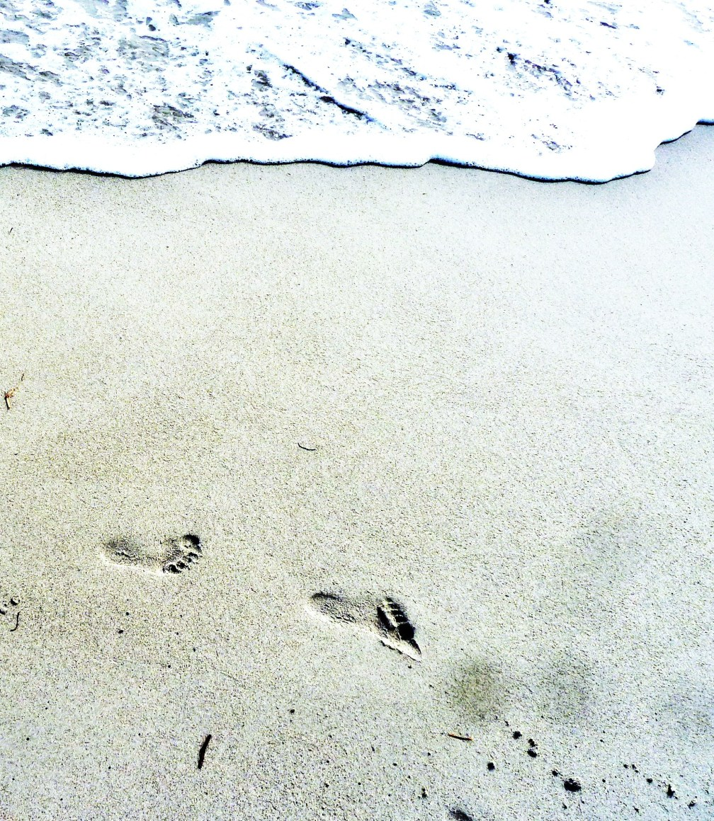 Footprints on the beach (2)
